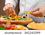 cook making delicious pizza at... | Shutterstock . vector #342242399