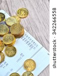 Small photo of Coins on bank account book
