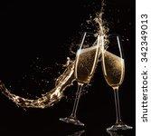 glasses of champagne with splash | Shutterstock . vector #342349013