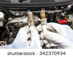 spark plug replacement work | Shutterstock . vector #342370934