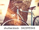 Old Bicycle Leaning Against A...