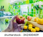 hand holding apple over cabinet ... | Shutterstock . vector #342400409