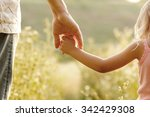 a the parent holds the hand of... | Shutterstock . vector #342429308