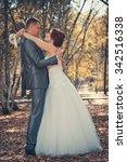 happy bride and groom walking... | Shutterstock . vector #342516338