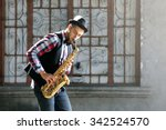 Young Man Plays Saxophone On...