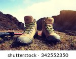 hiking boots on beautiful... | Shutterstock . vector #342552350