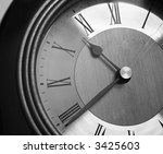 An old vintage clock in grayscale tones. - stock photo