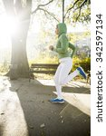 young woman running in the park | Shutterstock . vector #342597134