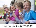 Family Enjoying Ice Cream...