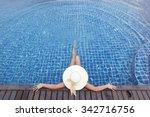 Woman In Big Hat Relaxing In...