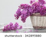 basket with a branch of lilac... | Shutterstock . vector #342895880