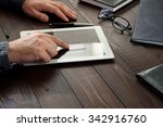 man working with a tablet...   Shutterstock . vector #342916760