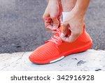 tie his shoes before jogging. | Shutterstock . vector #342916928