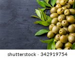 Pile Of Green Olives On Black...