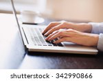 young adult using laptop | Shutterstock . vector #342990866