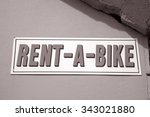 Rent A Bike Sign On Stone Wall...