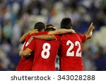football players hugging while... | Shutterstock . vector #343028288