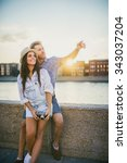 young tourists on the embankment | Shutterstock . vector #343037204