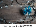 christmas gift box with blue... | Shutterstock . vector #343070579
