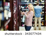 smiling woman holding bottle of ... | Shutterstock . vector #343077434