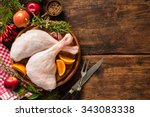 raw goose legs with herbs on... | Shutterstock . vector #343083338