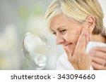 senior woman in bathroom... | Shutterstock . vector #343094660