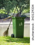 broom and green bin in garden | Shutterstock . vector #343129334