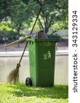 broom and green bin in garden | Shutterstock . vector #343129334