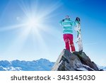 back view of female snowboarder ... | Shutterstock . vector #343145030
