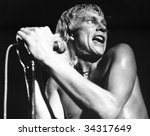 Small photo of LONDON-JULY 21: Andy Ellison, lead singer of British pop group Radio Stars, performs live on stage on July 21, 1978 in London. He had previously been in John's Children with the late Marc Bolan.