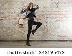 fashion model wearing leather... | Shutterstock . vector #343195493