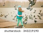 Little Girl Feeds The Pigeons...