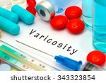 Small photo of Varicosity - diagnosis written on a white piece of paper. Syringe and vaccine with drugs.
