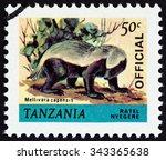 "Small photo of TANZANIA - CIRCA 1980: A stamp printed in Tanzania from the ""Animals "" issue shows Ratel (Mellivora capensis), circa 1980."