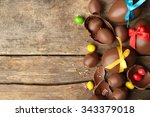Small photo of Chocolate Easter eggs on wooden background