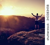 runner on the peak. man in his... | Shutterstock . vector #343383458
