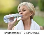 Senior Woman Drinking Water...