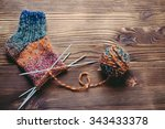 Knitted Sock  Ball Of Yarn And...