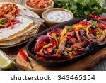 pork fajitas with onions and... | Shutterstock . vector #343465154