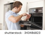 man repairing domestic oven in... | Shutterstock . vector #343486823