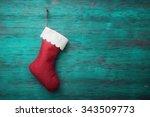 Red Santa Sock On Wooden...