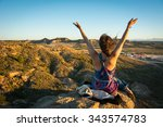 a girl sitting on a cliff...   Shutterstock . vector #343574783