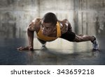 Stock photo sport young athletic man doing push ups muscular and strong guy exercising 343659218