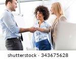 businesspeople shaking hands | Shutterstock . vector #343675628