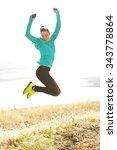 Backlit Runner Jumping For Joy