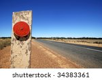 red reflector at the Eyre Highway in South Australia - stock photo