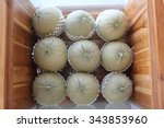 Melons In  Wood Box.