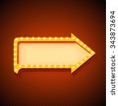 retro arrow with glowing lights.... | Shutterstock . vector #343873694