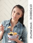 woman eating breakfast at home   Shutterstock . vector #343882610
