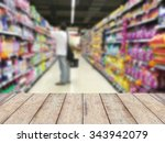 Stock photo wood floor and supermarket blur background product display 343942079